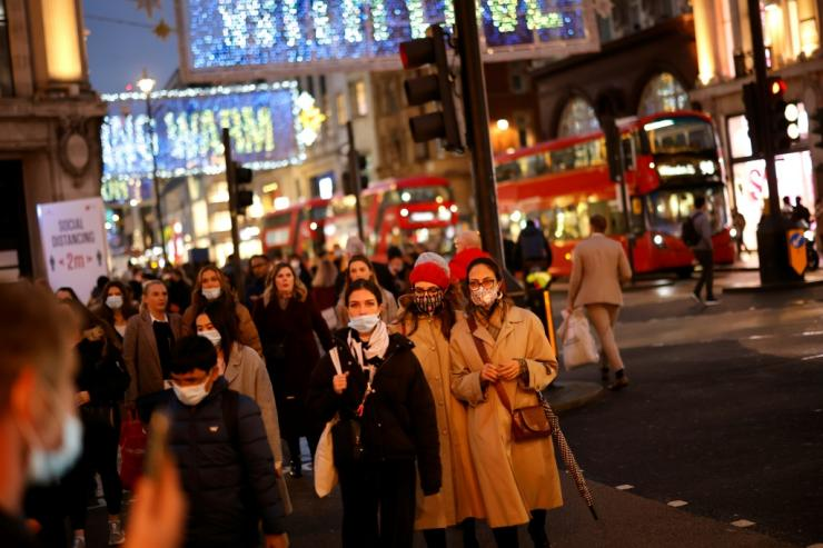 Shoppers on Oxford Street in London as it was announced that the city will move to the highest level of anti-virus restrictions