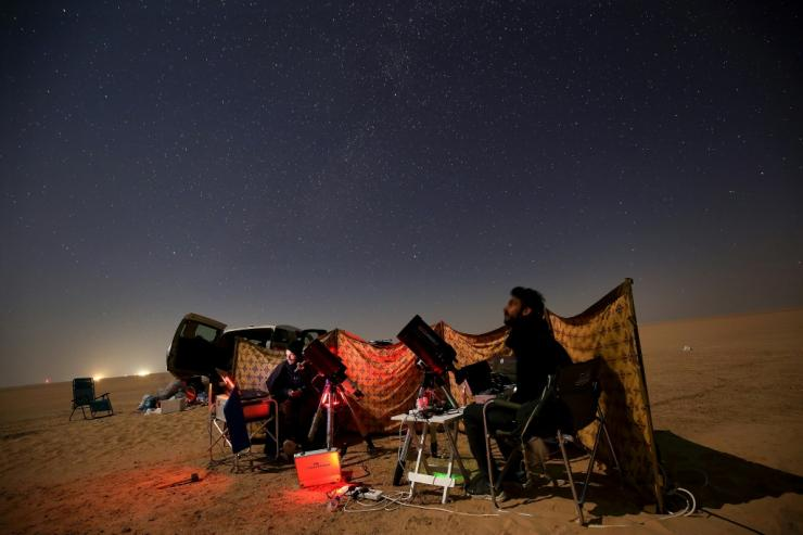 Kuwaiti astrophotographers follow the great conjunction between Jupiter and Saturn in al-Salmi district, west of Kuwait City, on December 21, 2020