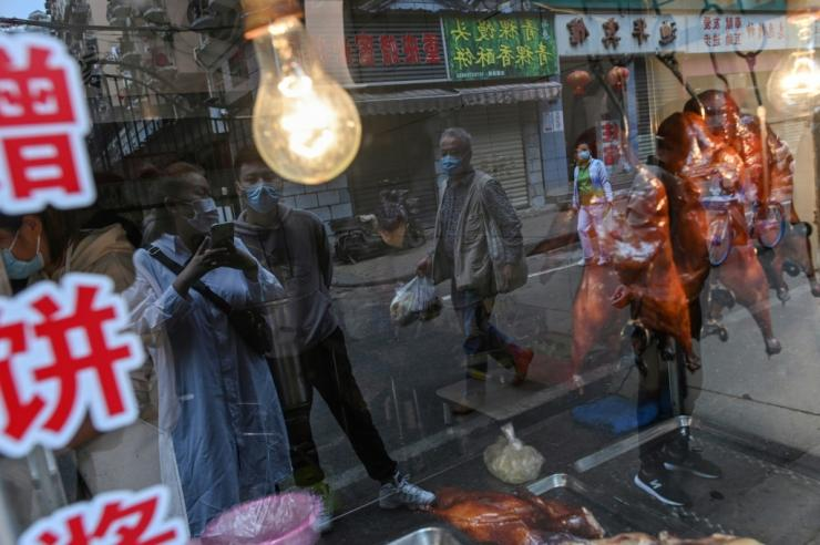 China's rapid economic growth has profoundly changed eating habits, with figures Wednesday revealing more than half of adults are now overweight