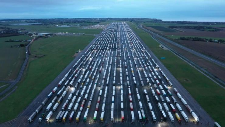 Hundreds of lorry drivers at the holding area of Manston Airport in Kent honk their horns for more than half an hour in apparent protest at the situation they're in. The drivers are stranded after France closed its borders to the UK.