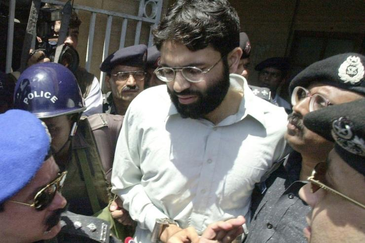 British-born militant Ahmed Omar Saeed Sheikh (pictured handcuffed on March 29, 2002) had been sentenced to death for the killing of American journalist Daniel Pearl