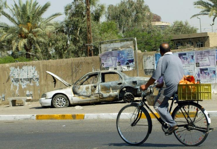The remains of a car burnt after Blackwater private security guards escorting US embassy officials opened fire in Baghdad's Nisur Square in 2007