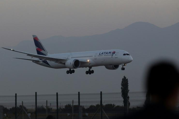 Chile began coronavirus vaccinations just hours after the first doses arrived by plane