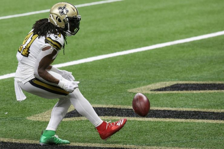 New Orleans Saints running back Alvin Kamara celebrates scoring one of his NFL record-tying six rushing touchdowns Friday in a victory over Minnesota