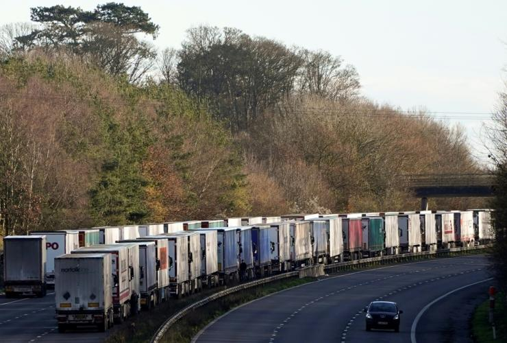 Thousands of trucks were backed up on motorways in southern England on Christmas Day even after France reopened border crossings it had closed due to the new virus strain