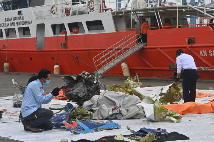 Indonesian investigators are combing through the wreckage of the crashed Sriwijaya Air 737 to try and explain why it went down