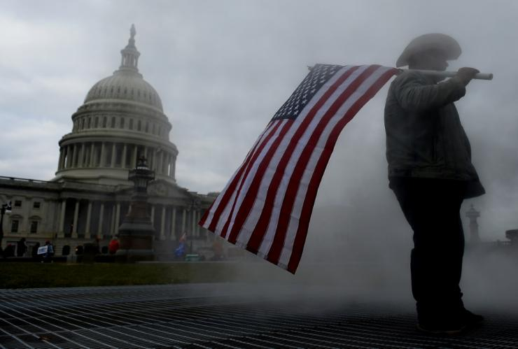 A supporter of US President Donald Trump stands outside US Capitol