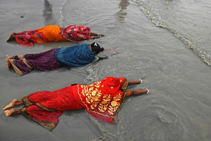 Hindu pilgrims offer prayers at the confluence of the Ganges and the Bay of Bengal
