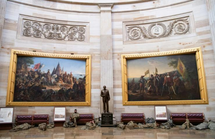 Members of the National Guard take a rest in the Rotunda of the US Capitol in Washington, DC, on January 13, 2021, ahead of the House vote impeaching US President Donald Trump