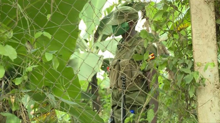Soldiers are seen outside the home of Ugandan opposition presidential candidate Bobi Wine, who told journalists the military had entered his property earlier.