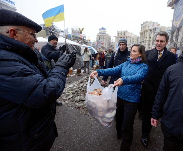 Victoria Nuland nominated for another top position of the State Department distributing cakes to protesters at the Independence Square in Kiev in December 2013