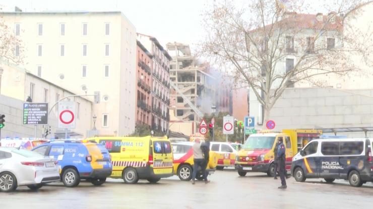 Madrid emergency services rush to the site of a strong explosion in Madrid that has killed at least two people