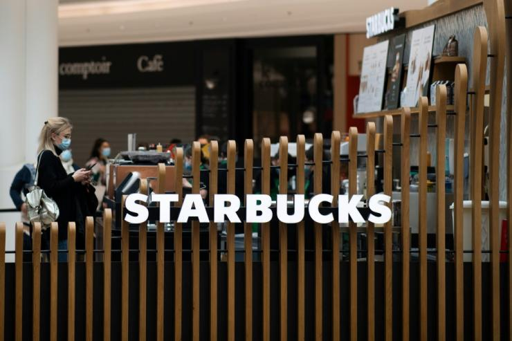 Starbucks reported a drop in profits but is nonetheless bouncing back after its business suffered during the most severe Covid-19 restrictions
