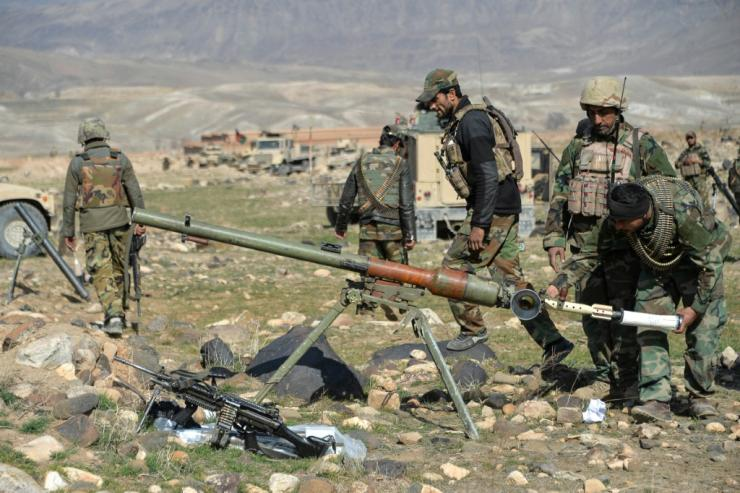 Afghan security forces fire on Taliban positions during an operation against Taliban militants in the Sherzad District of Nangarhar Province on February 9,2021