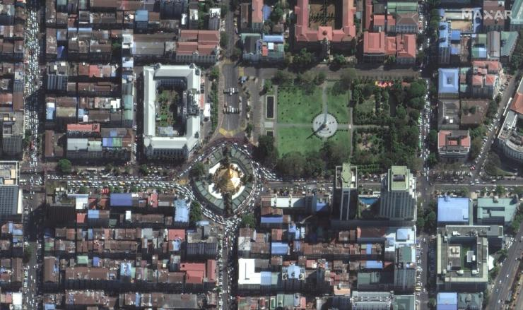 This handout satellite image released by Maxar Technologies shows protests and security forces near Yangon city hall on Tuesday