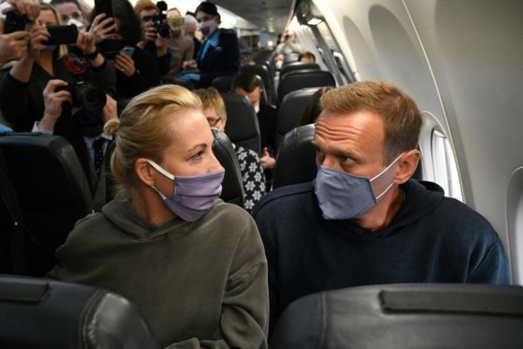 Russian opposition leader Navalny and his wife Yulia on January 17, flying back to Moscow from Berlin where he was treated for poisoning