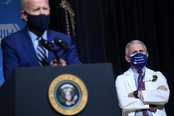 US President Joe Biden, pictured February 11, 2021 with White House Chief Medical Adviser on Covid-19 Dr Anthony Fauci (R), has made tackling the pandemic a priority of his new administration