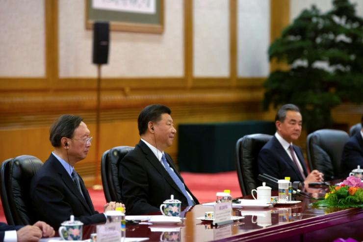 Senior Chinese official Yang Jiechi (L), China's President Xi Jinping (C), and China's Foreign Minister Wang Yi (R) in Beijing in 2019