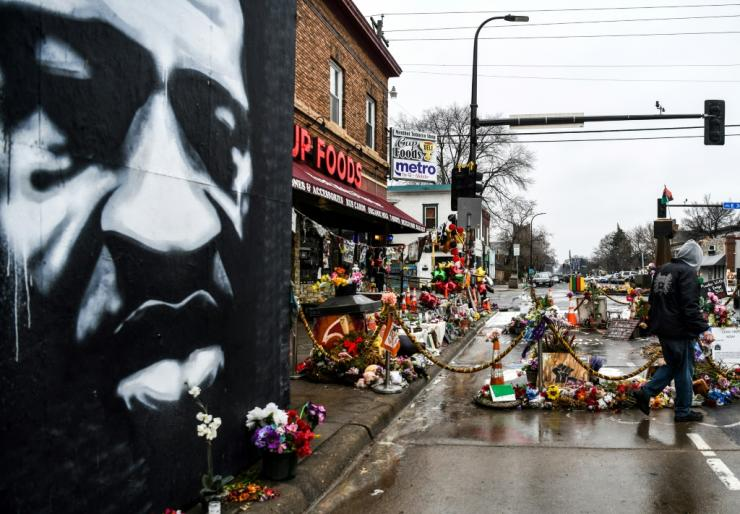 A mural and a memorial to George Floyd on Minneapolis Street where he died