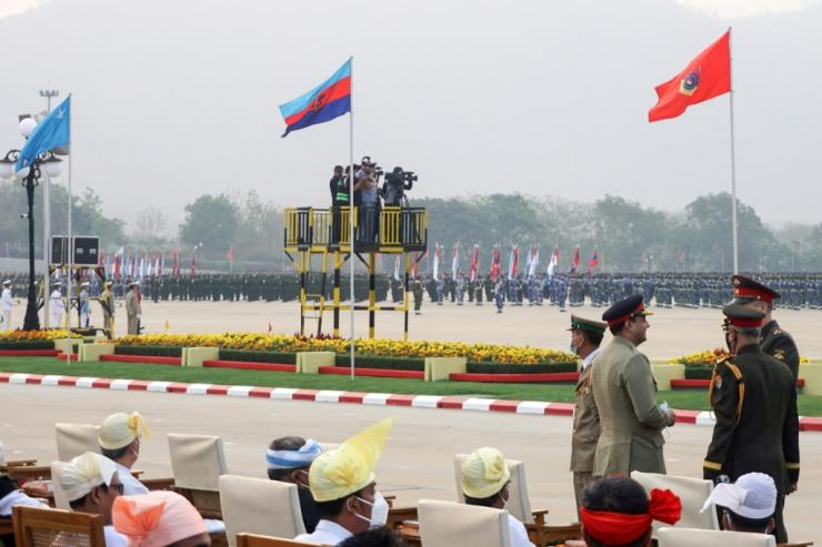 """In the capital Naypyidaw there was a grand parade of troops and military vehicles, and junta leader General Min Aung Hlaing warned in a speech that acts of """"terrorism"""" were unacceptable"""