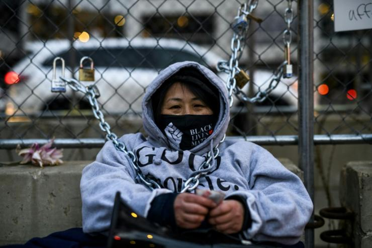 Teacher and activist Kaia Hirt chained herself to a fence outside the Hennepin County Government Center where former Minneapolis police officer Derek Chauvin is on trial for the death of George Floyd