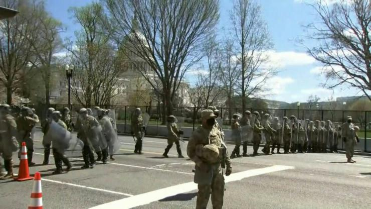 IMAGESMembers of the National Guard arrive on a street near the US Capitol after two police officers were injured when they were rammed by a vehicle whose driver was subsequently arrested.