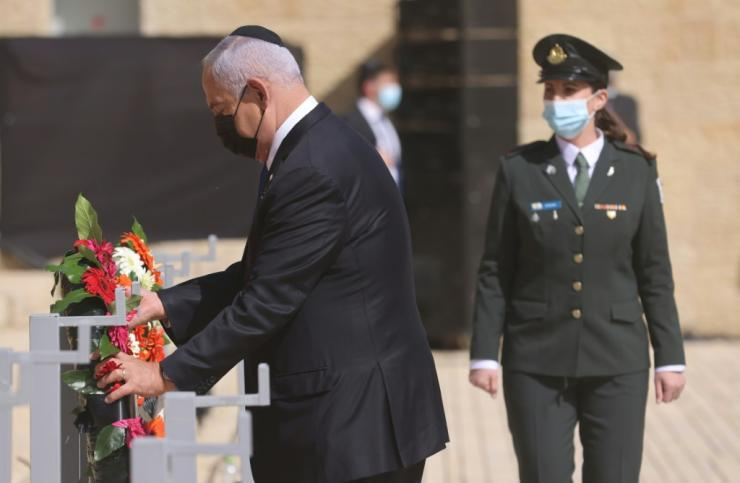 Israeli Prime Minister Benjamin Netanyahu attends a wreath laying ceremony to commemorate the Holocaust Remembrance at Warsaw Ghetto Square in the Yad Vashem Memorial Hall in Jerusalem