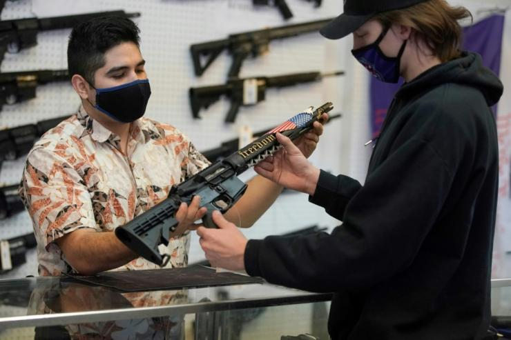 Customers see a custom-made AR-15 style rifle at a shop in Orem, Utah in February 2021