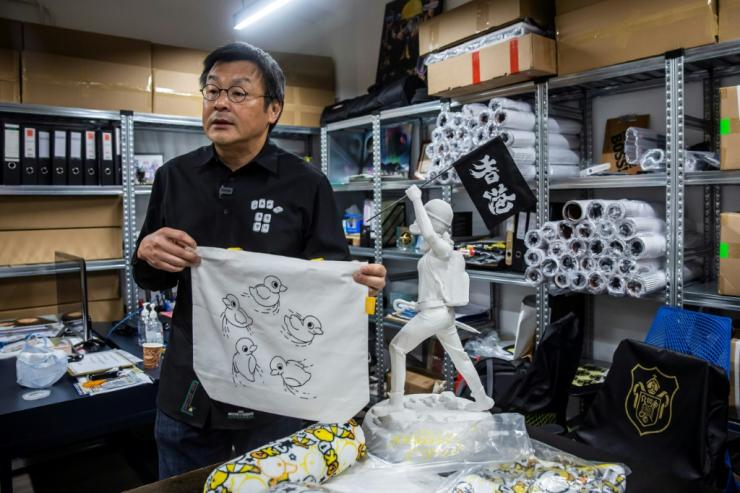 "Chow makes no secret of his messaging -- the tote bag, for example, carries a referemce to popular Hong Kong protest slogan ""Five demands, not one less"