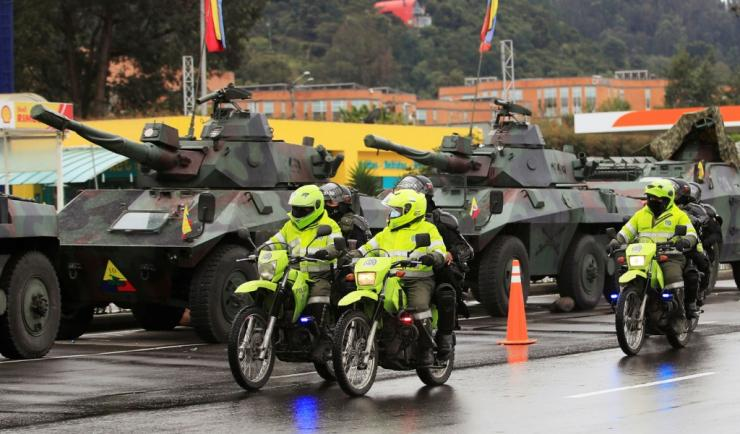 Riot police passed military tanks on the outskirts of Bogotá on May 4, 2021