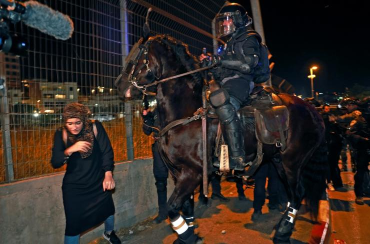 Israeli mounted policemen disperse protesters during a demonstration by Palestinians against the possible eviction of Palestinian families from their homes in Sheikh Jarrah