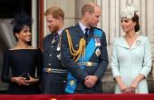 Britain's Meghan, Duchess of Sussex, Prince Harry, Prince William, Catherine, Duchess of Cambridge  stand on the balcony of Buckingham Palace as they watch a fly past to