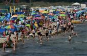 Despite COVID-19 fears, people enjoy warm summer weather at a beach near the Baltic Sea village of Binz, northern Germany