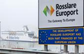 "On the sloping approach to the docks, a sign welcomes the steady stream of traffic to ""Rosslare Europort: the gateway to Europe"""